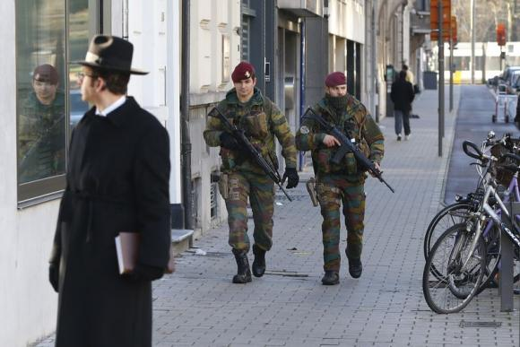Belgian paratroopers patrol in the Jewish area of central city of Antwerp